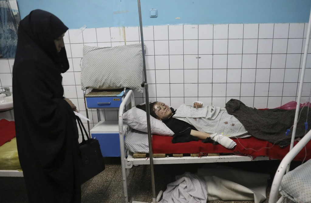 An Afghan school student is treated at a hospital after a bomb explosion near a school west of Kabul, Afghanistan, Saturday, May 8, 2021. A bomb explo...