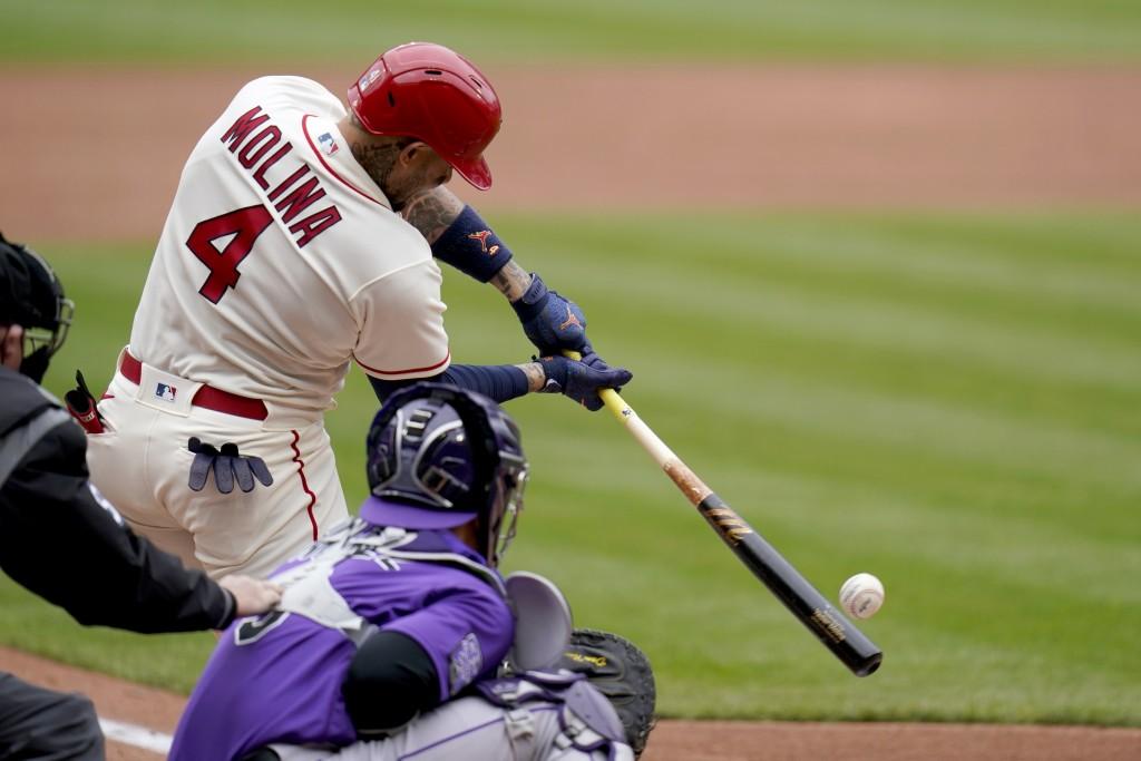 St. Louis Cardinals' Yadier Molina (4) hits a two-run single during the third inning of a baseball game against the Colorado Rockies Saturday, May 8, ...