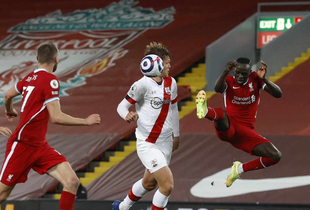 Liverpool's Sadio Mane, right, kicks the ball during the English Premier League soccer match between Liverpool and Southampton at Anfield stadium in L...