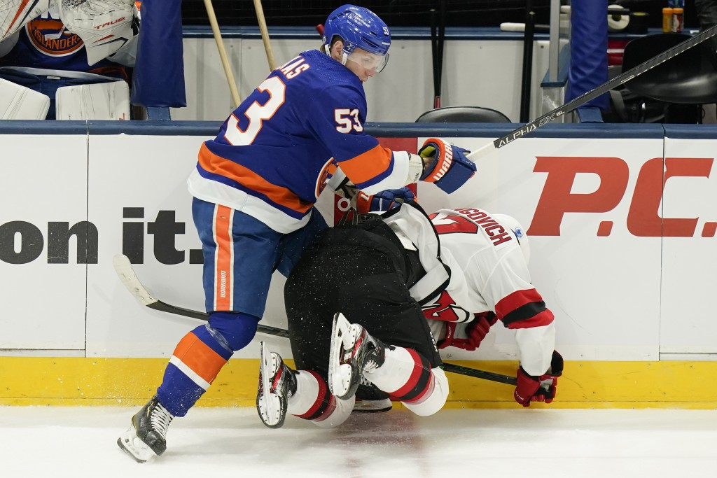 New York Islanders' Casey Cizikas (53) checks New Jersey Devils' Yegor Sharangovich (17) during the second period of an NHL hockey game Saturday, May ...