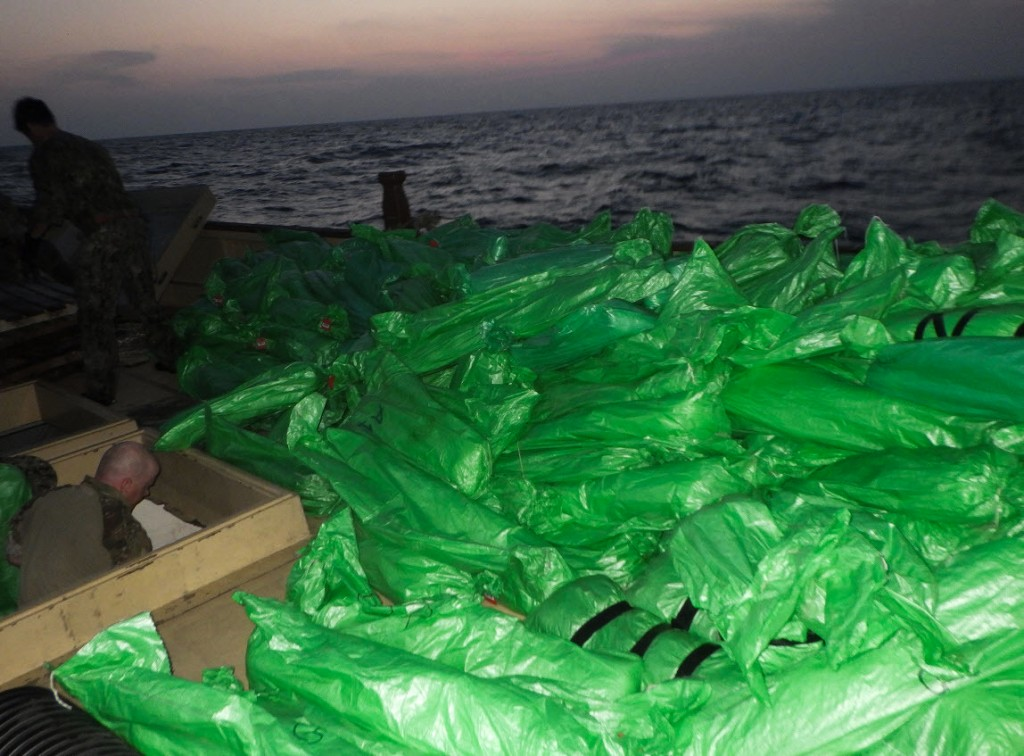 Plastic-wrapped weapons are seen on the deck of a stateless dhow that the U.S. Navy said carried a hidden arms shipment in the Arabian Sea on Friday, ...