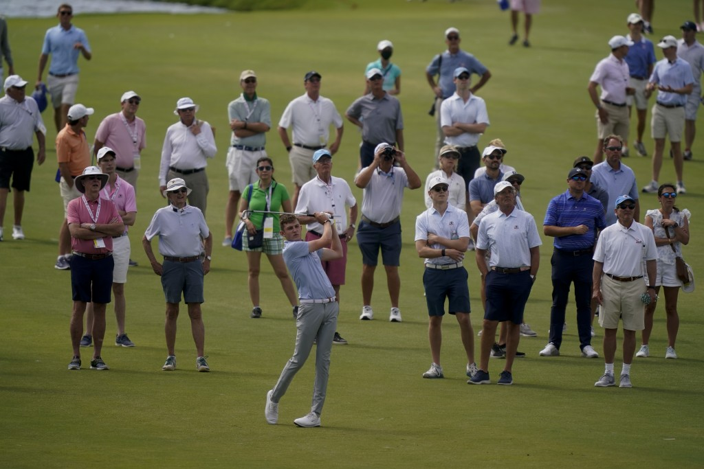 Barclay Brown, of the Great Britain and Ireland team, watches his shot on the 11th hole in the foursome matches during the Walker Cup golf tournament ...