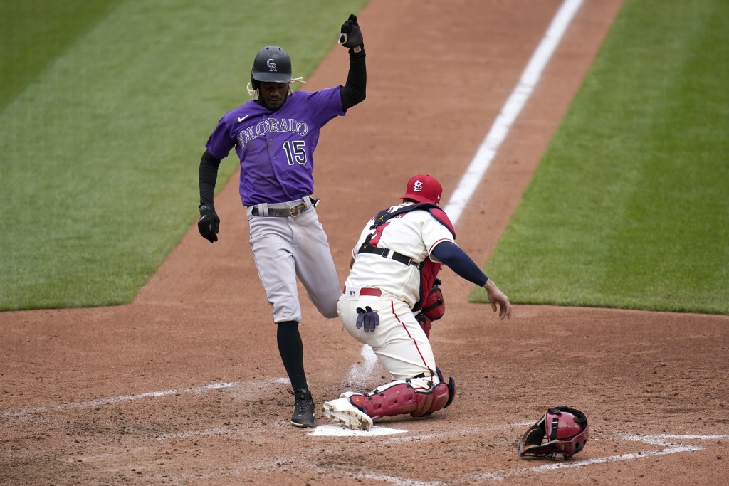 Colorado Rockies' Raimel Tapia (15) is forced out as St. Louis Cardinals catcher Yadier Molina covers home during the fifth inning of a baseball game ...