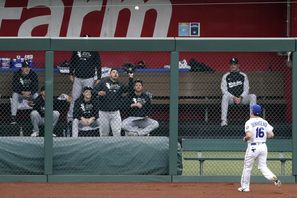 Kansas City Royals left fielder Andrew Benintendi watches as a two-run home run hit by Chicago White Sox's Danny Mendick falls into the White Sox bull...