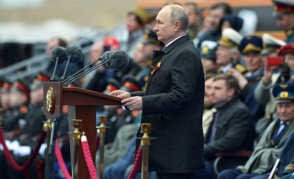 Russian President Vladimir Putin delivers his speech during the Victory Day military parade in Moscow, Russia, Sunday, May 9, 2021, marking the 76th a...