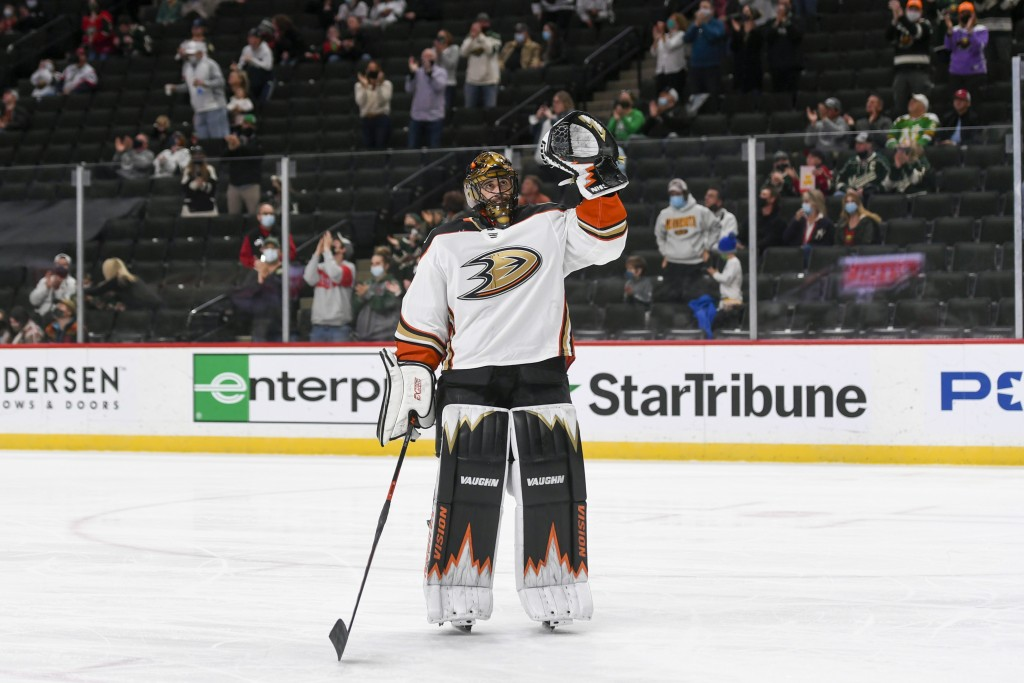 Anaheim Ducks goalie Ryan Miller waves to the crowd during a standing ovation after it was announced that this would be his last NHL hockey game, agai...