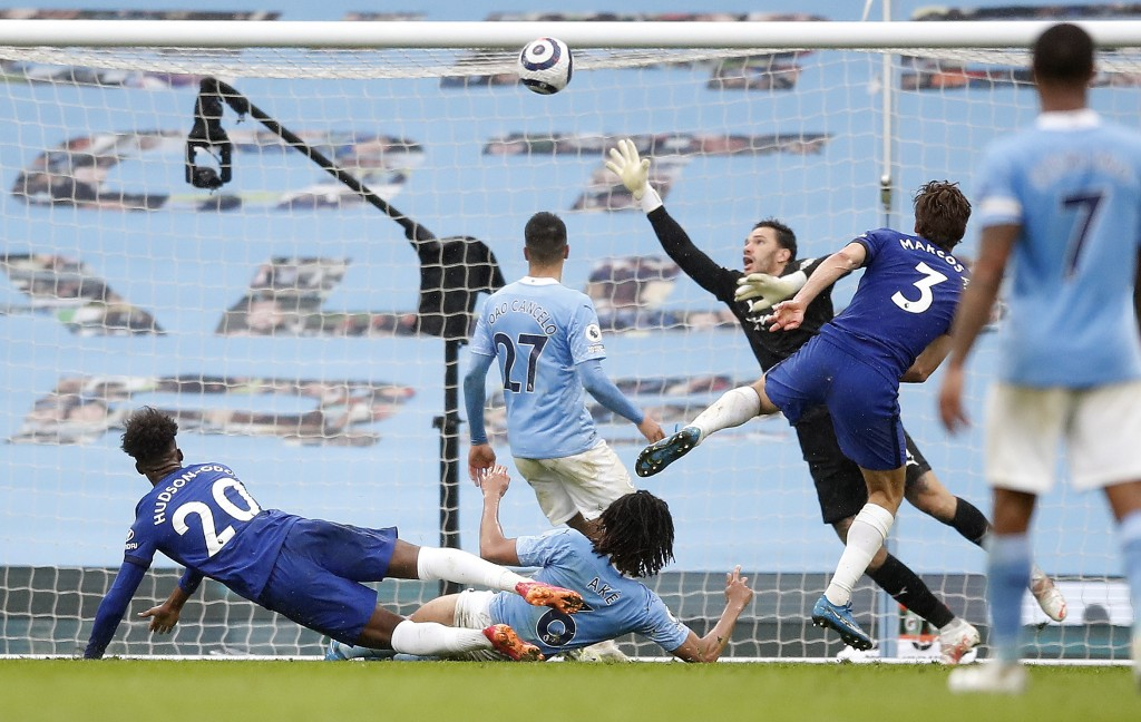 Chelsea's Marcos Alonso scores the winning goal during the English Premier League soccer match between Manchester City and Chelsea at the Etihad Stadi...