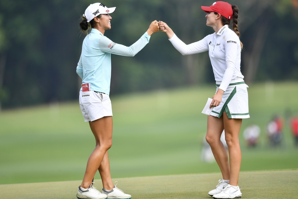 Lydia Ko of New Zealand, left, and Gaby Lopez of Mexico touch their hands after finishing their play on the 18th hole during the final round of the LP...