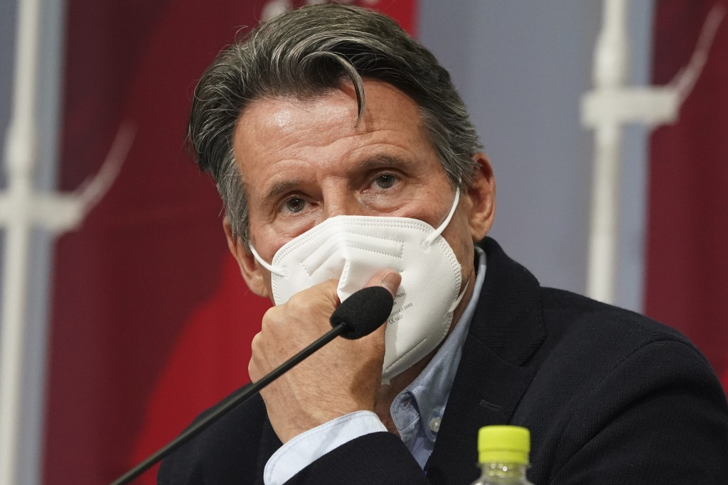 Sebastian Coe, president of World Athletics, listens to a reporter's question during a press conference as Coe visited an athletics test event for the...