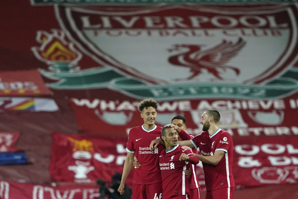 Liverpool's Thiago, center, celebrates with teammates after scoring his side's second goal during the English Premier League soccer match between Live...