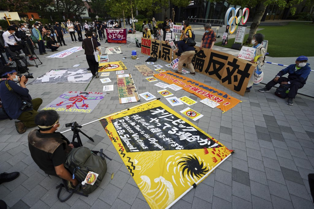 People against the Tokyo 2020 Olympics set to open in July, protest around Tokyo's National Stadium during the anti-Olympics demonstration Sunday, May...