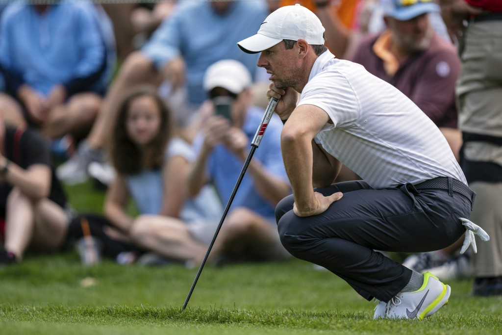 Rory McIlroy lines up his putt on the first hole during the third round of the Wells Fargo Championship golf tournament at Quail Hollow on Saturday, M...
