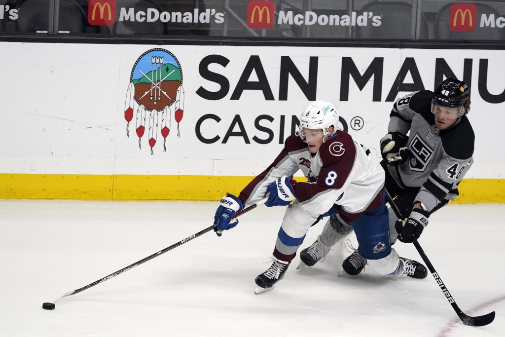 Colorado Avalanche defenseman Cale Makar (8) reaches for the puck next to Los Angeles Kings left wing Brendan Lemieux (48) during the first period of ...