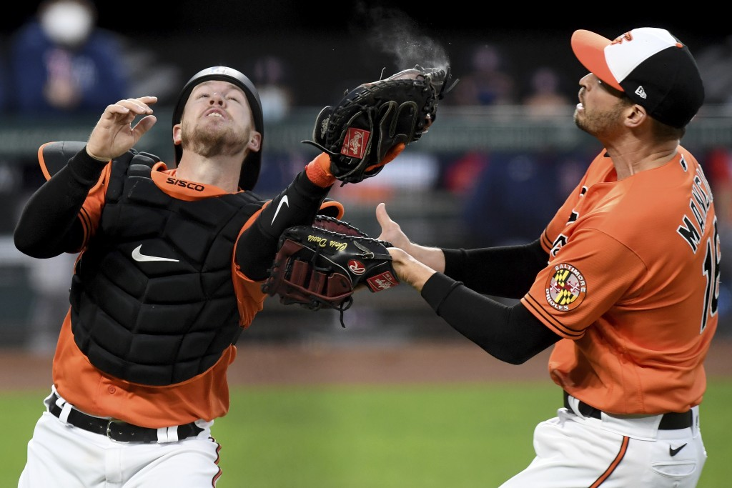 Baltimore Orioles catcher Chance Sisco catches a foul ball from Boston Red Sox's Hunter Renfroe in front of teammate Trey Mancini in the third inning ...