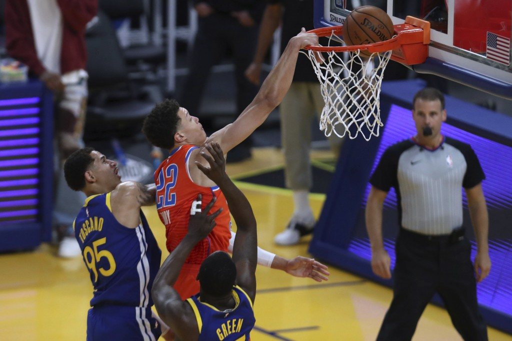 Oklahoma City Thunder's Isaiah Roby, center, shoots against Golden State Warriors' Draymond Green, right, and Juan Toscano-Anderson, left, during the ...