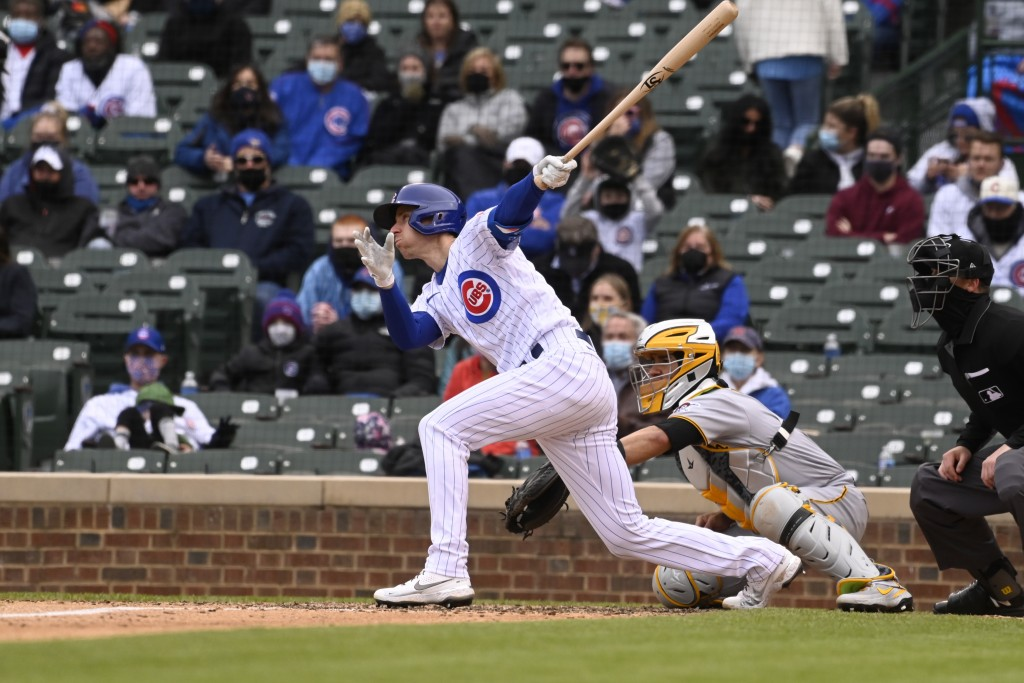 Chicago Cubs' Matt Duffy (5) hits an RBI single during the seventh inning of a baseball game against the Pittsburgh Pirates, Saturday, May 8, 2021, in...