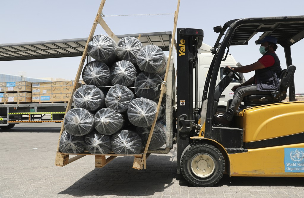 A forklift driver loads material for temporary shelters to be sent to India, at the UNHCR warehouses, part of the International Humanitarian City, in ...