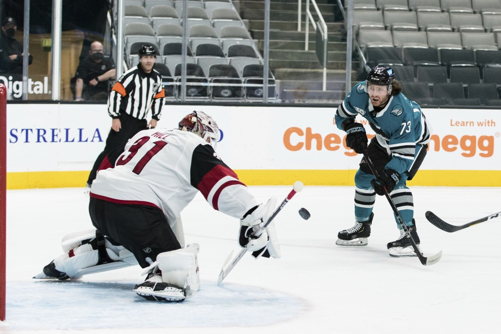 Arizona Coyotes goaltender Adin Hill (31) blocks a shot by San Jose Sharks center Noah Gregor (73) during the first period of an NHL hockey game in Sa...