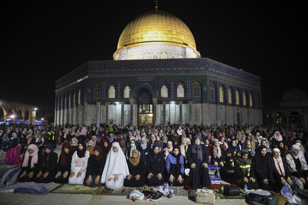 Palestinian Muslim worshippers pray during the Laylat al-Qadr, or the night of destiny, in the holy fasting month of Ramadan, in front of the Dome of ...