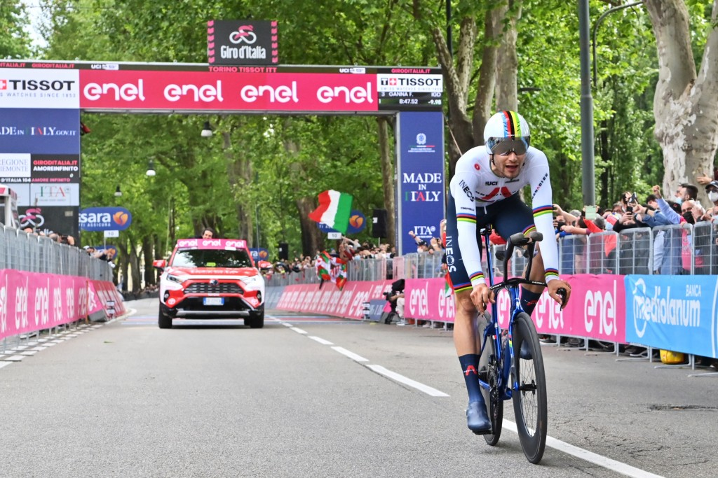 Italy's Filippo Ganna arrives at the finish line of the opening stage of the Giro d'Italia cycling race, an individual time trial in Turin, Italy, Sat...