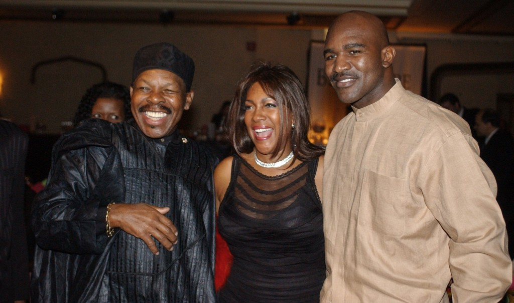 FILE - In this Feb. 20, 2003 file photo,   Lloyd Price, left, and Mary Wilson, of the Supremes, pose for a photograph with boxer Evander Holyfield dur...