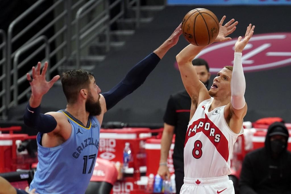 Toronto Raptors guard Malachi Flynn (8) gets his shot blocked by Memphis Grizzlies center Jonas Valanciunas (17) during the second half of an NBA bask...