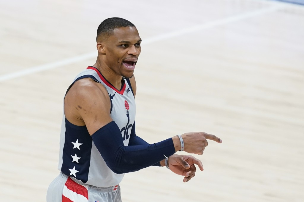 Washington Wizards' Russell Westbrook shouts instructions during the first half of the team's NBA basketball game against the Indiana Pacers, Saturday...