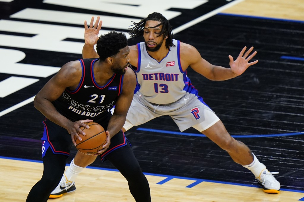 Philadelphia 76ers' Joel Embiid ,left, tries to get around Detroit Pistons' Jahlil Okafor during the first half of an NBA basketball game, Saturday, M...