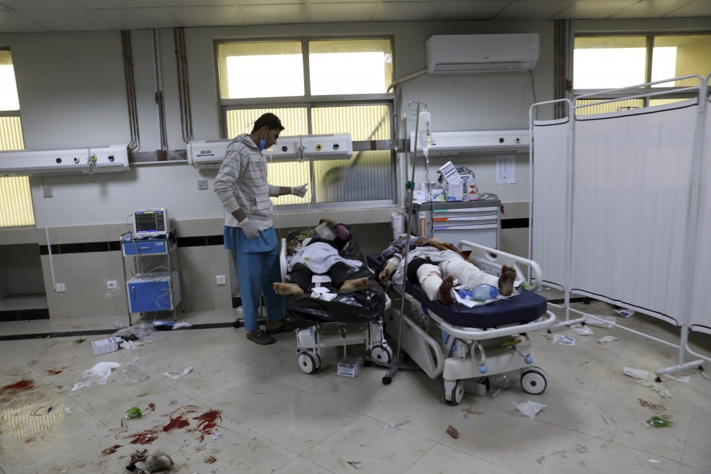 Afghan school students are treated at a hospital after a bomb explosion near a school in west of Kabul, Afghanistan, Saturday, May 8, 2021. A bomb exp...