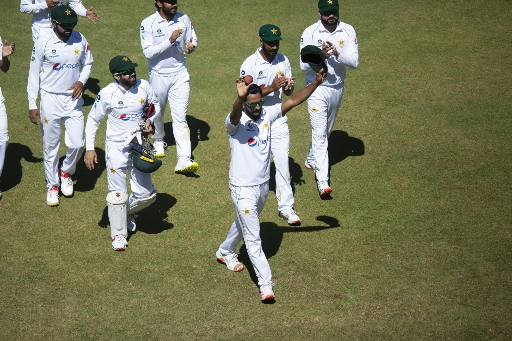 Pakistan bowler Hassan Ali ,centre, holds a cricket ball after taking 5 wickets, during the second test cricket match between Zimbabwe and Pakistan at...
