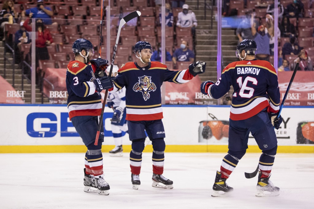 Florida Panthers center Sam Bennett (9) celebrates after scoring a goal with defenseman Keith Yandle (3) and center Aleksander Barkov (16) during the ...