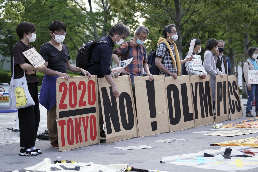 People against the Tokyo 2020 Olympics set to open in July, protest around Tokyo's National Stadium during an anti-Olympics demonstration Sunday, May ...