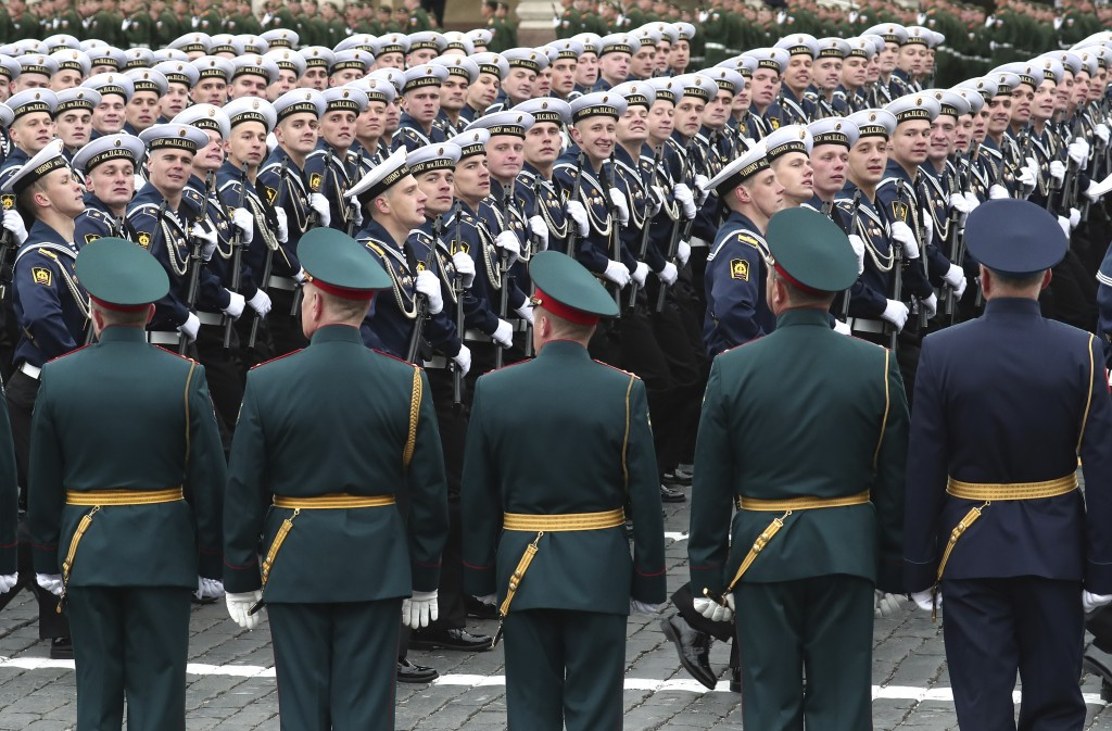 Russian sailors march toward Red Square during the Victory Day military parade in Moscow, Russia, Sunday, May 9, 2021, marking the 76th anniversary of...