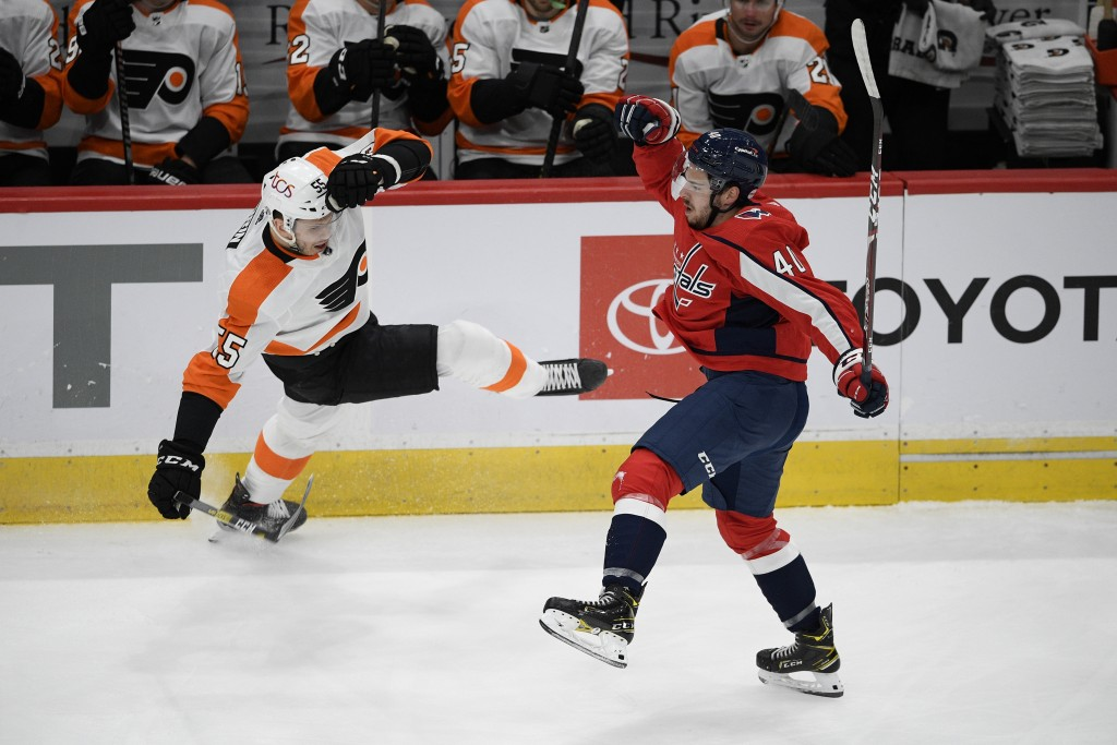 Washington Capitals center Garrett Pilon (40) and Philadelphia Flyers left wing Samuel Morin (55) lose their balance after colliding during the first ...
