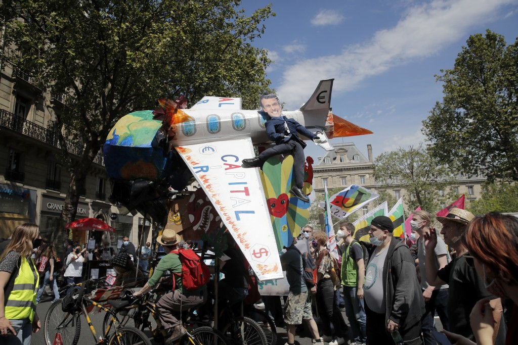 Demonstrators march during a rally against the climate change in Paris, Sunday, May 9, 2021. thousands of French demonstrators took to the streets of ...