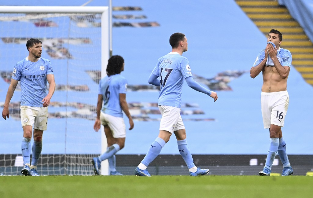 Manchester City players look dejected after Chelsea scored during the English Premier League soccer match between Manchester City and Chelsea at the E...