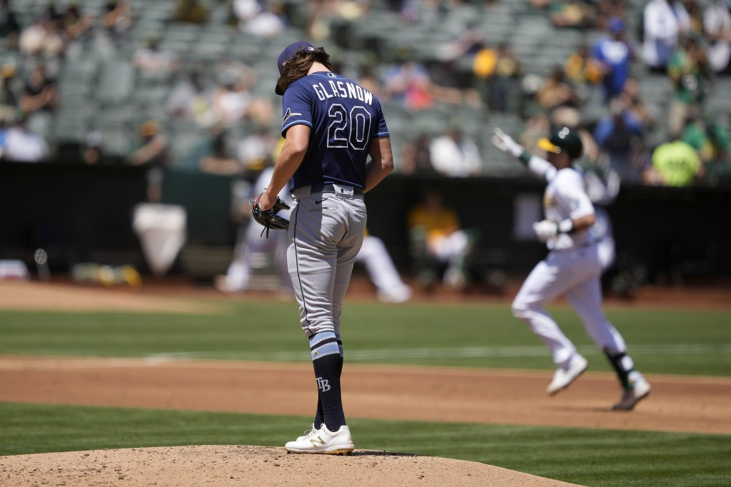 Tampa Bay Rays starting pitcher Tyler Glasnow (20) stands on the mound as Oakland Athletics' Oakland Athletics' Austin Allen, right, rounds the bases ...