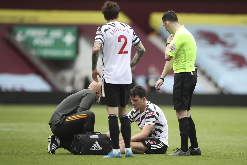 Manchester United's Harry Maguire receives medical treatment during the English Premier League soccer match between Aston Villa and Manchester United ...