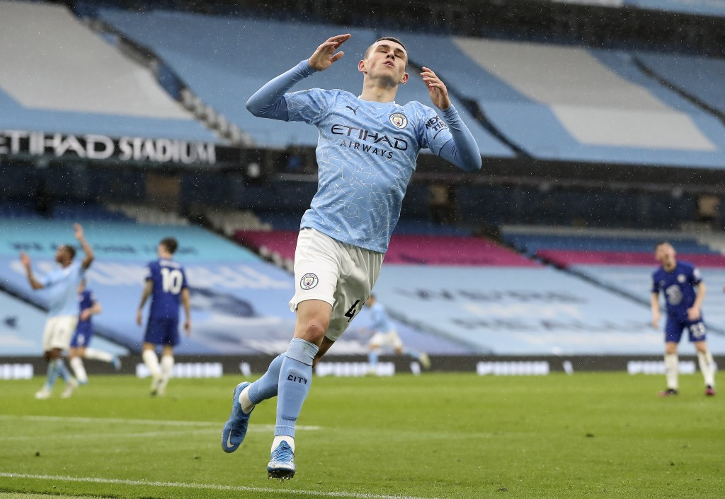 Manchester City's Phil Foden reacts after a missed chance during the English Premier League soccer match between Manchester City and Chelsea at the Et...