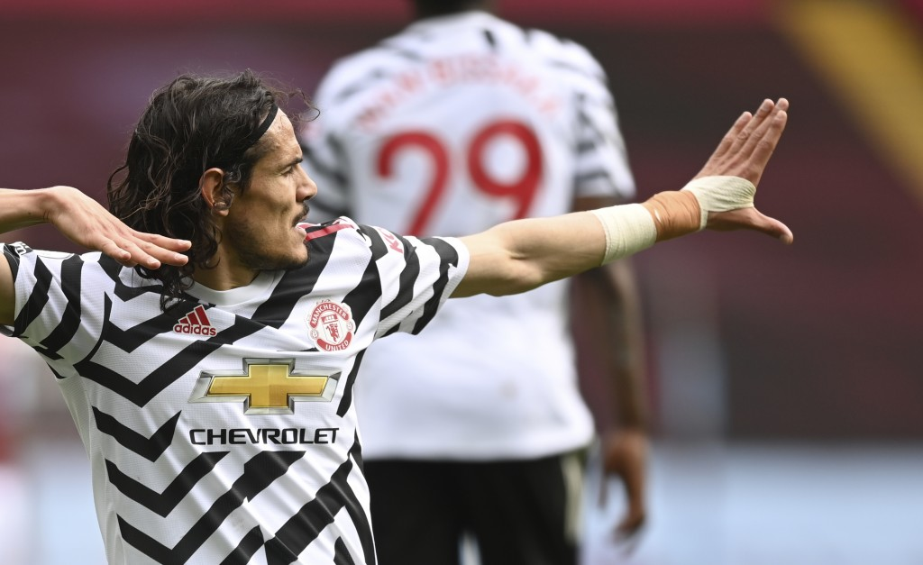 Manchester United's Edinson Cavani celebrates after scoring his side's third goal during the English Premier League soccer match between Aston Villa a...