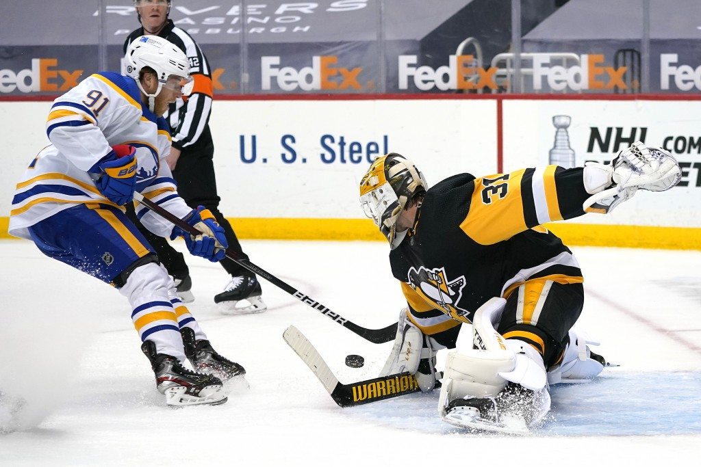 Pittsburgh Penguins goaltender Maxime Lagace (31) stops a break away shot by Buffalo Sabres' Drake Caggiula during the second period of an NHL hockey ...