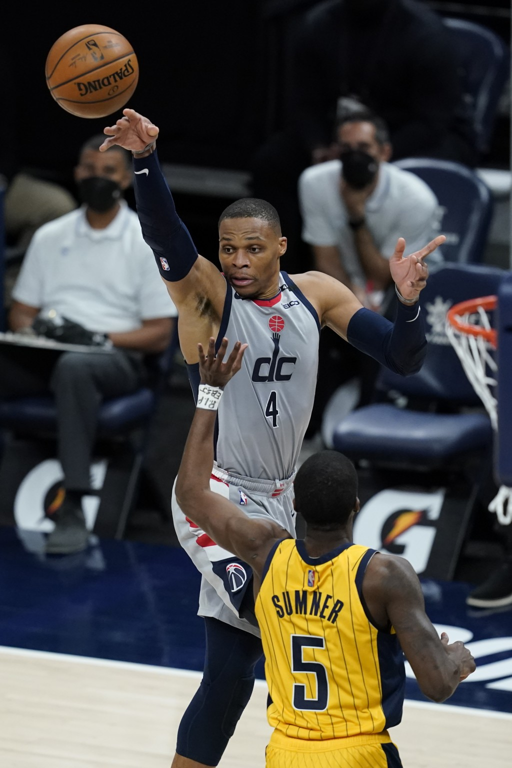 Washington Wizards' Russell Westbrook (4) makes a pass against Indiana Pacers' Edmond Sumner (5) during the first half of an NBA basketball game, Satu...