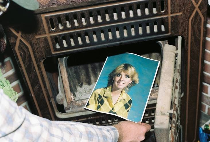 his undated photo provided by the Yavapai County Sheriff's Office shows a law enforcement official discovering a photograph of Pamela Pitts in the woo...