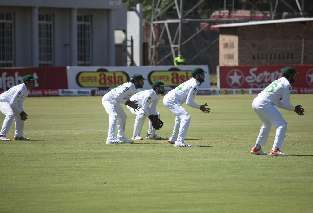 Pakistan players position themselves, during the second test cricket match between Zimbabwe and Pakistan at Harare Sports Club, Sunday, May, 9, 2021.(...