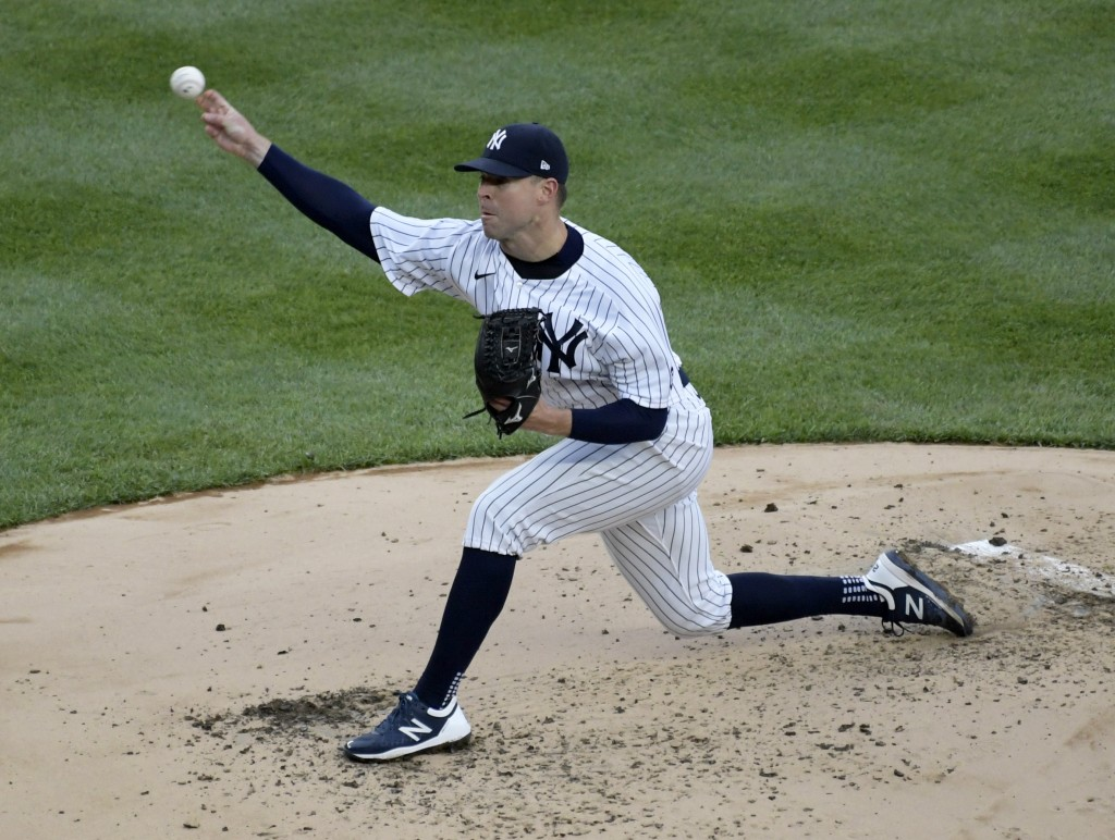 New York Yankees pitcher Corey Kluber throws during the third inning of a baseball game against the Washington Nationals, Saturday, May 8, 2021, at Ya...