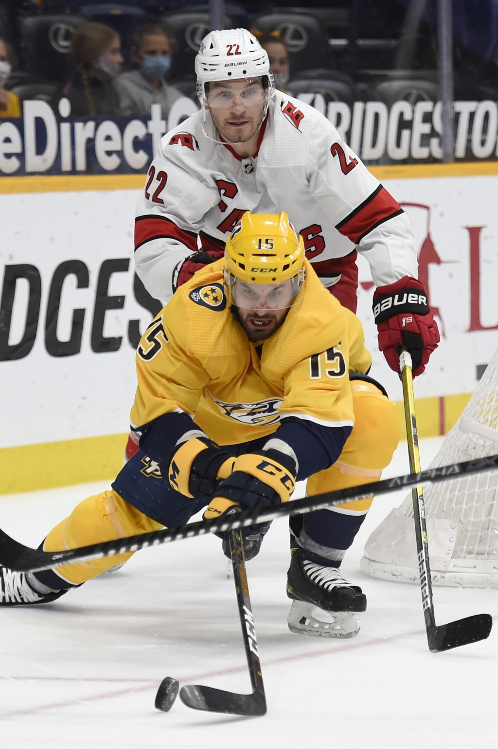 Nashville Predators right wing Brad Richardson (15) reaches for the puck in front of Carolina Hurricanes defenseman Brett Pesce (22) during the second...