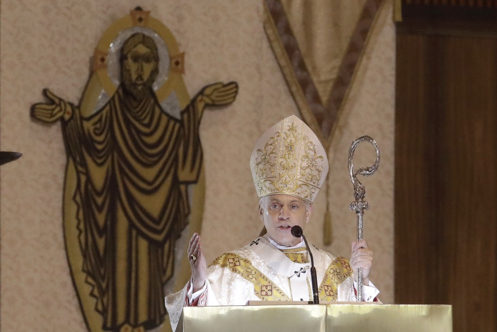 In this Sunday, April 12 2020 photo, San Francisco Archbishop Salvatore Cordileone celebrates Easter Mass, which was live streamed, at St. Mary's Cath...