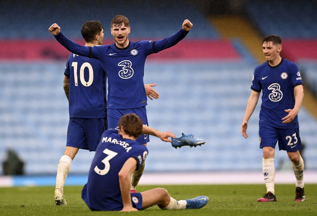 Chelsea's Timo Werner, centre, and Chelsea's Marcos Alonso, front, celebrate after winning the English Premier League soccer match between Manchester ...
