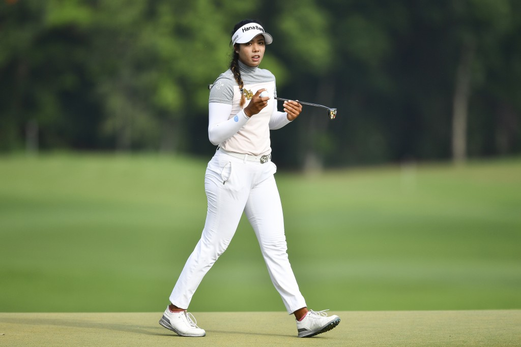 Patty Tavatanakit of Thailand holds the ball after finishing her play on the 18th hole during the final round of the LPGA Honda Thailand golf tourname...