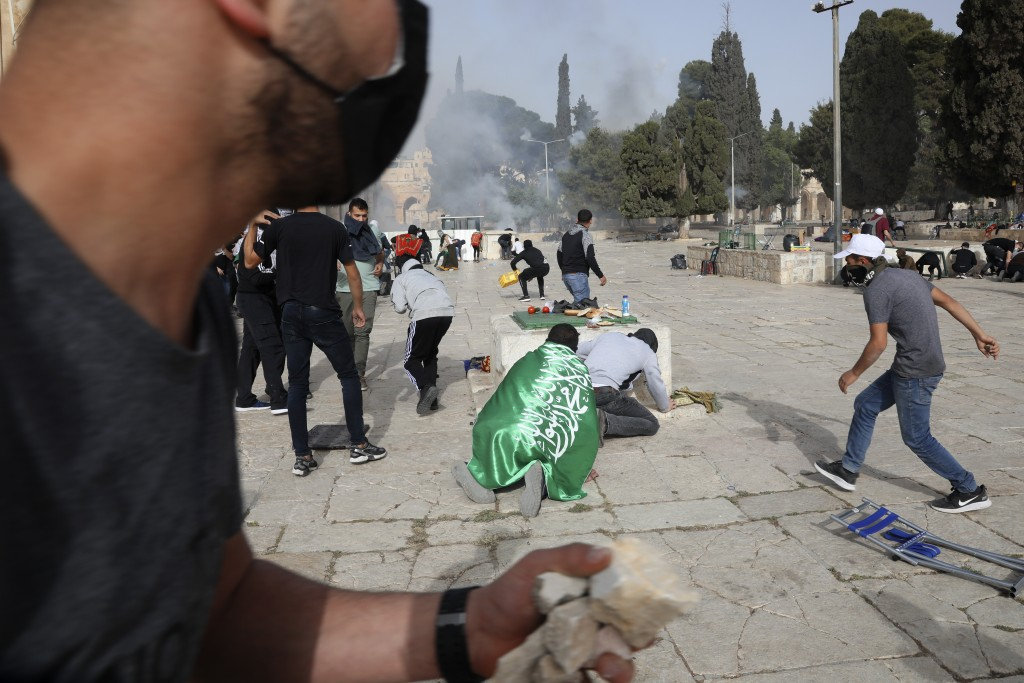 Palestinians clash with Israeli security forces at the Al Aqsa Mosque compound in Jerusalem's Old City Monday, May 10, 2021. Israeli police clashed wi...